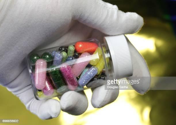 Close-up shot of a hand holding prescription pills