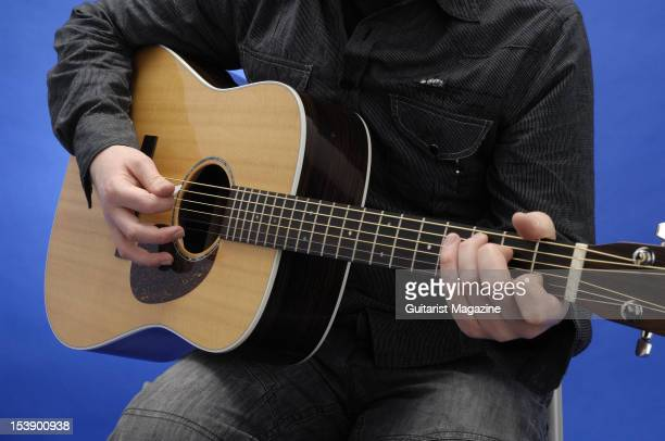 Close-up shot of a man playing an acoustic guitar, during a studio shoot for Guitarist Magazine/Future via Getty Images, March 30, 2010.