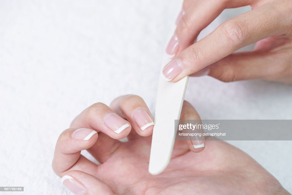 Closeup Shot Of A Woman In A Nail Salon Receiving A Manicure By A ...