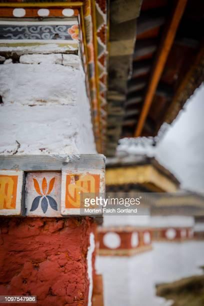 close-up shot of chortens at the dochula mountain pass in dochula, bhutan springtime - dochula pass stock-fotos und bilder