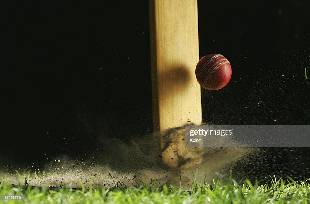 Close-up shot of cricket bat hitting ball : Stock Photo