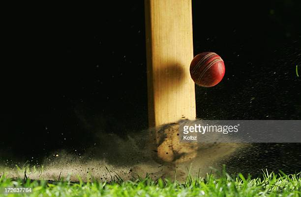 close-up shot of cricket bat hitting ball - cricket stockfoto's en -beelden