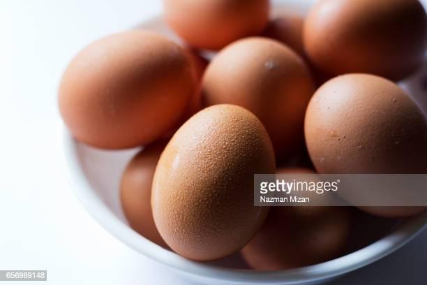 A closeup shot of eggs in a bowl. A food concept.