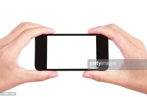 Closeup shot of hands holding mobile phone