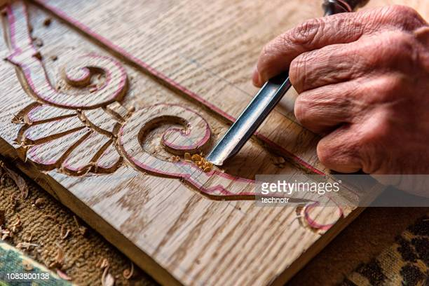 close-up shot of human hand carving sculpture - carving craft product stock pictures, royalty-free photos & images