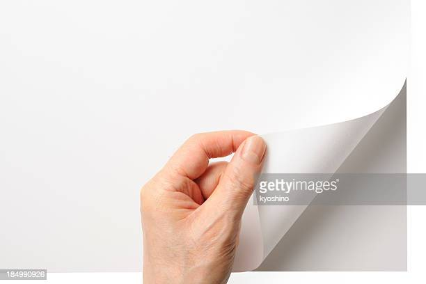 close-up shot of opening a blank page by the hand - turning stock pictures, royalty-free photos & images