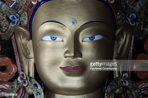 close-up shot of statue of maitreya buddha at thiksey monastery, ladakh, india - tibetan culture stock pictures, royalty-free photos & images
