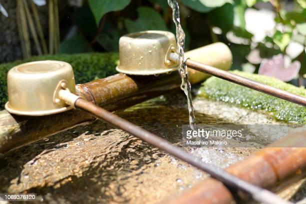 close-up shot of stone water basin - wabi sabi stock pictures, royalty-free photos & images