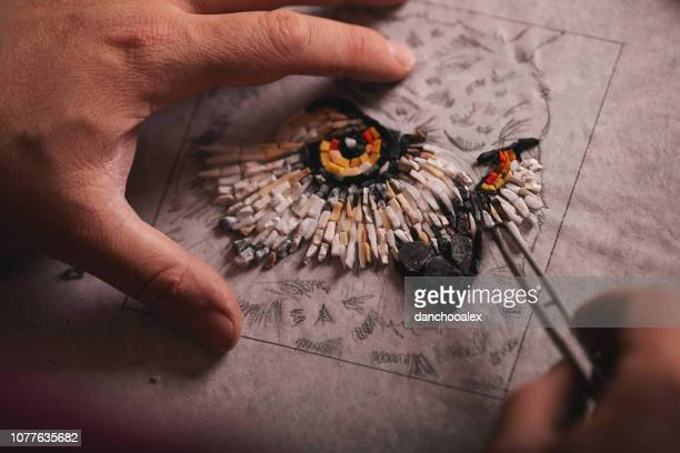 closeup shots of man working on mosaic - photo mosaic stock pictures, royalty-free photos & images