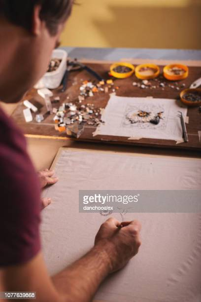 closeup shots of man working on mosaic - glass cutter stock photos and pictures