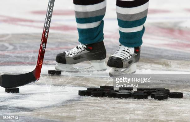 A closeup shows hockey pucks on the ice before the Mighty Ducks of Anaheim game against the Ottawa Senators at Scotiabank Place on January 19 2006 in...