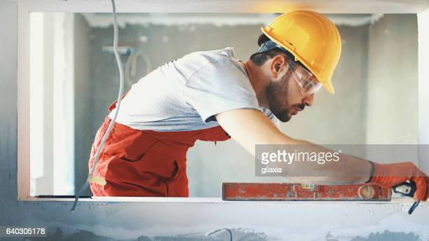 closeup side view of a construction worker. - wall building feature stock pictures, royalty-free photos & images