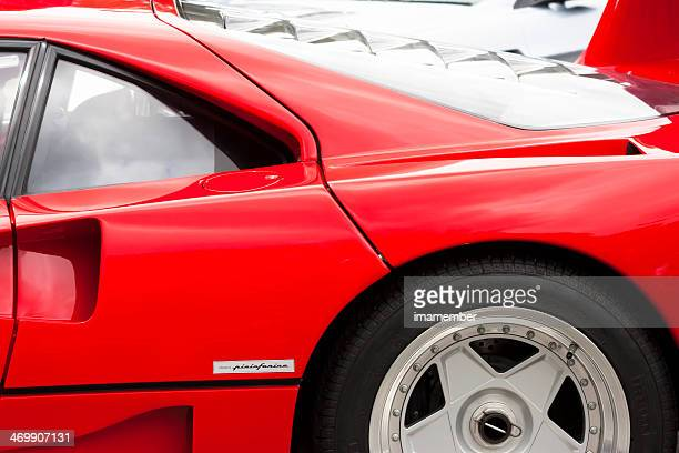 Closeup side view of Red Ferrari F40 with alloy wheel