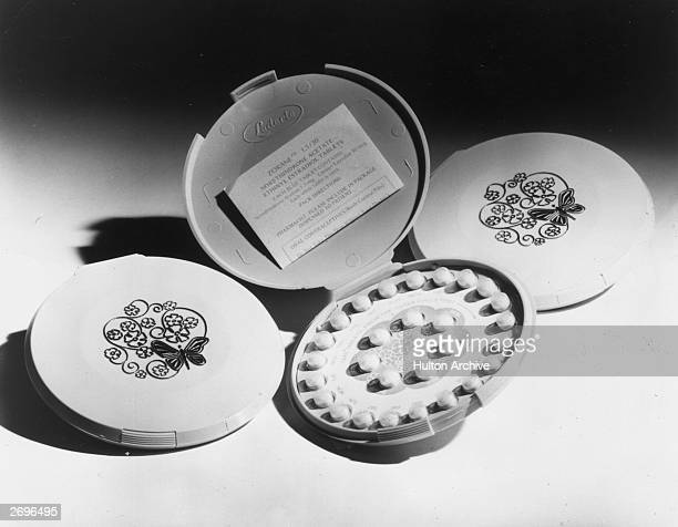 Closeup still life of Zorane tablets a series of lowestrogen birth control pills Shown are three packs one open two closed