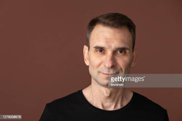 close-up studio portrait of 45 year old man - 45 49 years stock pictures, royalty-free photos & images