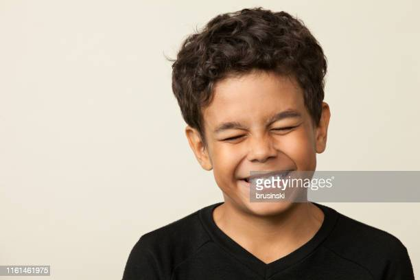 closeup studio portrait of a 12 year old boy on a beige background - beige background stock pictures, royalty-free photos & images