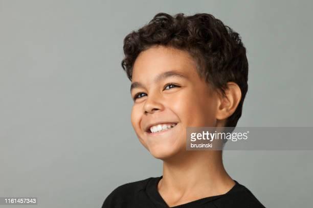 closeup studio portrait of a 12 year old boy on gray background - retrato formal imagens e fotografias de stock