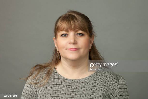 close-up studio portrait of a 45 year old woman - 45 49 years stock pictures, royalty-free photos & images