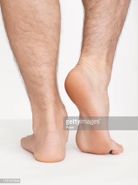Close-up studio shot of man's leg on white background