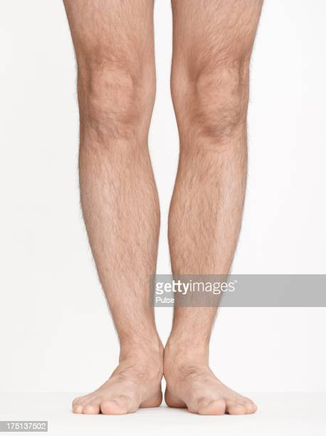 Close-up studio shot of man's legs on white background