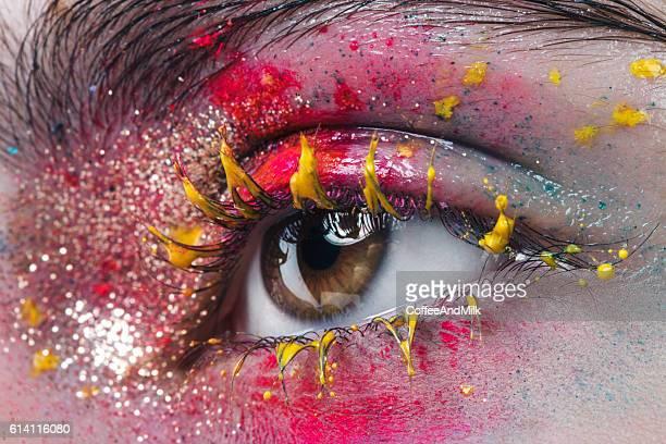 Close-up studio shot of woman eye