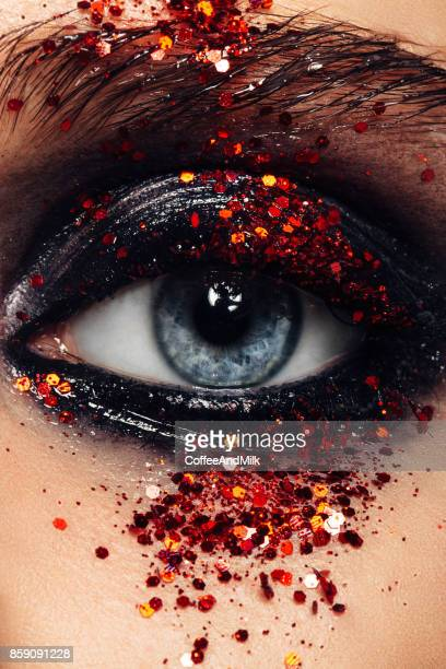 close-up studio shot of woman eye - stage make up stock photos and pictures
