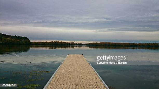 Close-Up Surface Level Of Jetty Against Calm Lake