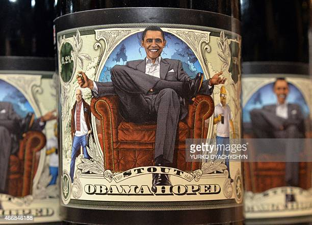 A closeup taken at the Beer Theater a restaurant in the western Ukrainian city of Lviv shows on March 19 2015 a bottle of Obama Hoped stout brewed at...