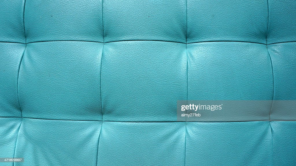 Closeup Texture Of Vintage Blue Leather Sofa For Background