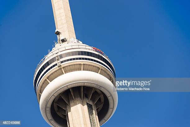 Closeup to the top of the CN Tower where people walking around the edge EdgeWalk is Torontos newest and tallest urban adventure and the worlds...