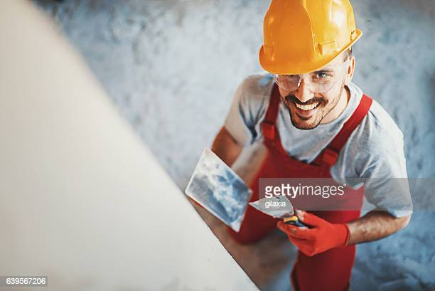 closeup top view of a construction worker. - wall building feature stock pictures, royalty-free photos & images