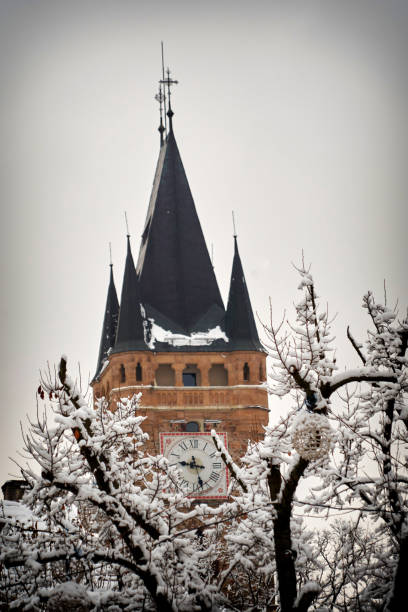 Close-up Tower whit clock, Church of Baia Mare, the capital of Maramures County, fist snow romania winter city
