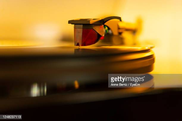 close-up tracking cartridge tonearm turntable - golden hour stock pictures, royalty-free photos & images