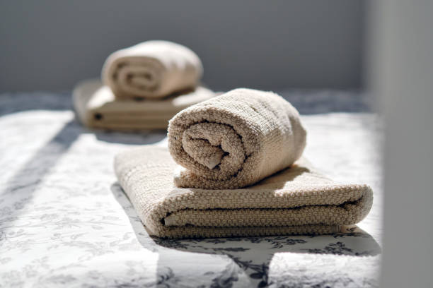 Closeup two fresh clean folded rolled towels