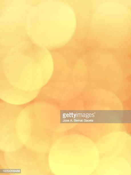 Close-up unfocused lights in the shape of circles of colors outdoors, wallpaper of light pastel colored color. High resolution photography.