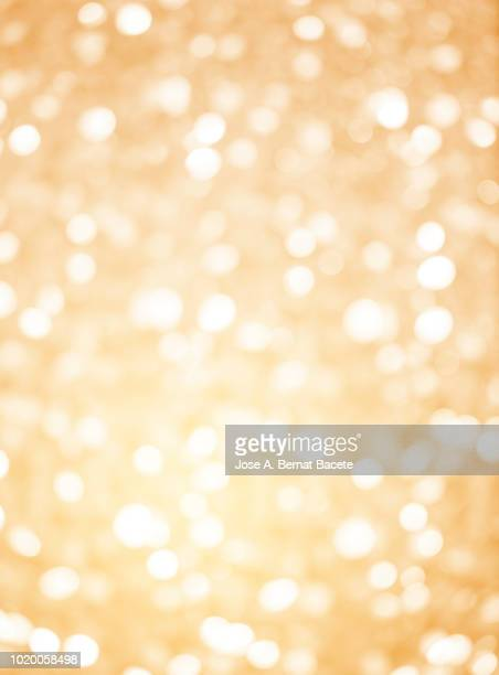 Close-up unfocused lights in the shape of circles of colors outdoors, wallpaper of light pastel colored color.