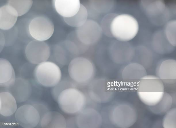 Close-up unfocused lights in the shape of circles of  gray background