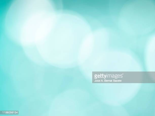 close-up unfocused lights in the shape of circles of light blue background. - turquoise colored stock pictures, royalty-free photos & images