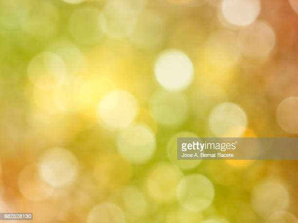 Close-up unfocused lights in the shape of circles of  orange and yellow background