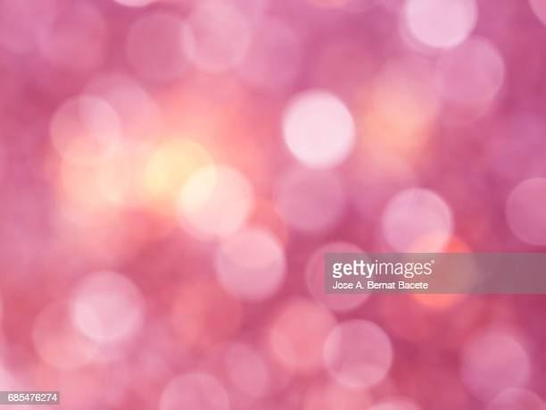Close-up unfocused lights in the shape of circles of  pink background