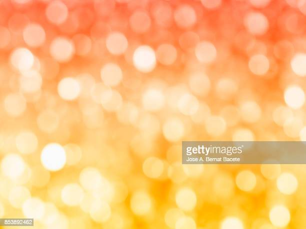 Close-up unfocused lights in the shape of circles of red and yellow  background