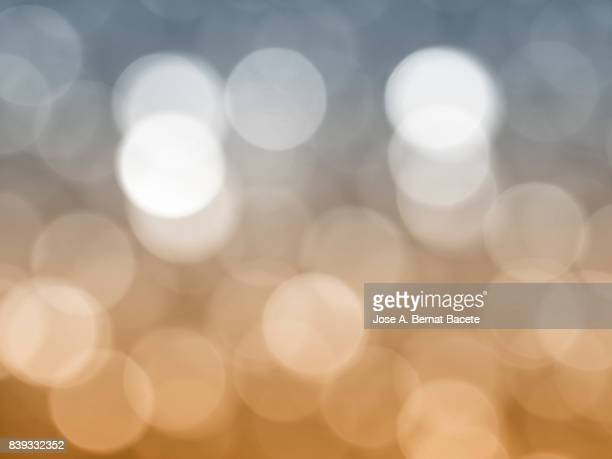 Close-up unfocused lights in the shape of circles of vintage blue and brown background