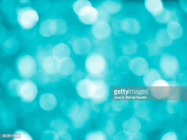 Close-up unfocused lights in the shape of circles of vintage blue background