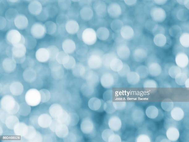 close-up unfocused lights in the shape of circles of vintage blue background - light blue stock pictures, royalty-free photos & images