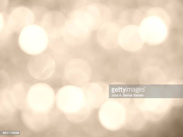 Close-up unfocused lights in the shape of circles of  vintage brown background