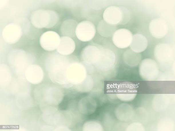 Close-up unfocused lights in the shape of circles of vintage green background
