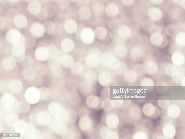 Close-up unfocused lights in the shape of circles of vintage pastel colored background