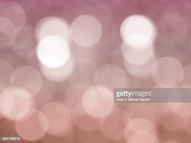 Close-up unfocused lights in the shape of circles of vintage red background