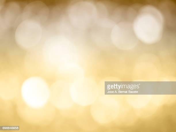 Close-up unfocused lights in the shape of circles of vintage yellow and brown background