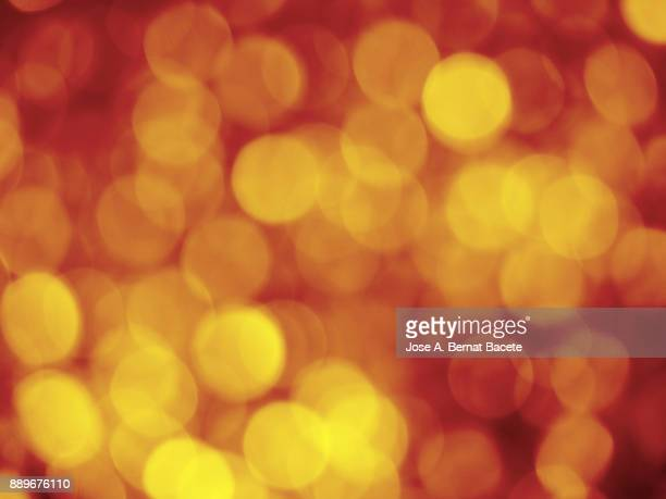 Close-up unfocused lights in the shape of circles of yellow and red background
